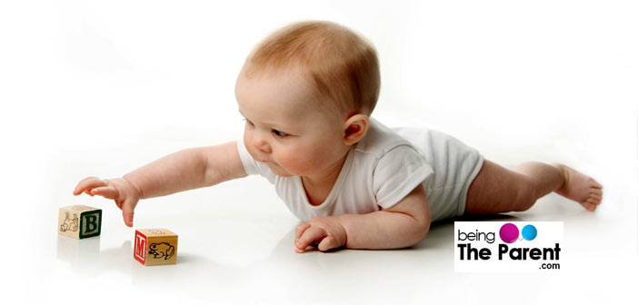Baby reaches for toys