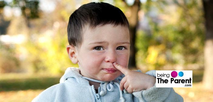 Nose picking toddler