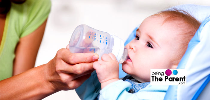 Giving water to baby