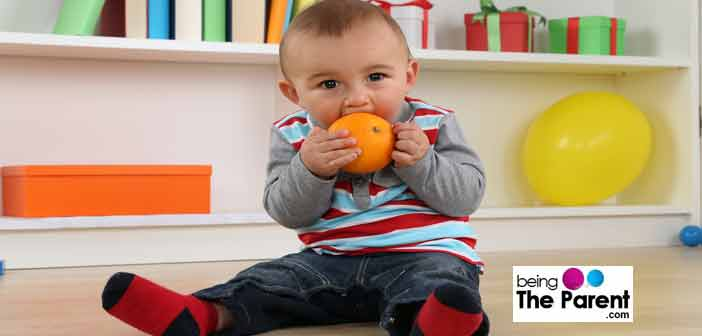toddler having orange
