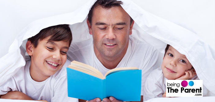 Father reading to boys