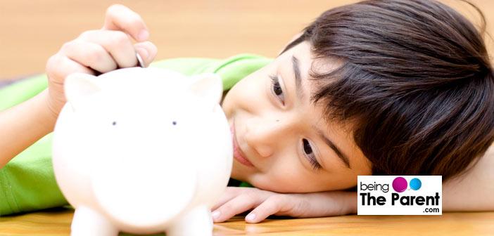 Young boy saving money