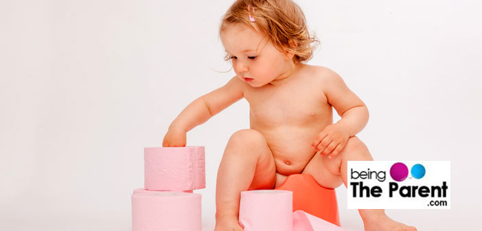 girl sitting on potty