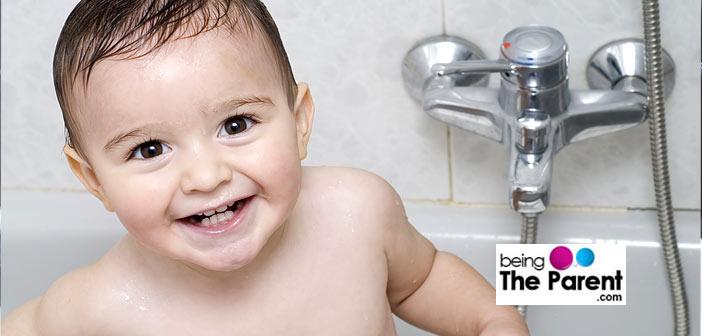 Happy toddler bathing