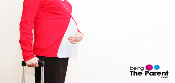 pregnant woman standing- travel concept