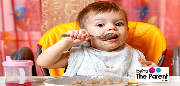 Baby boy eating food