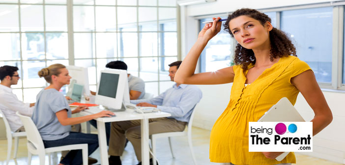 Pregnant woman in office