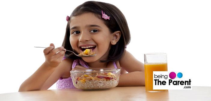 Girl eating breakfast cereal