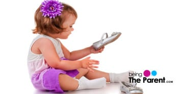 Toddler puts on shoes