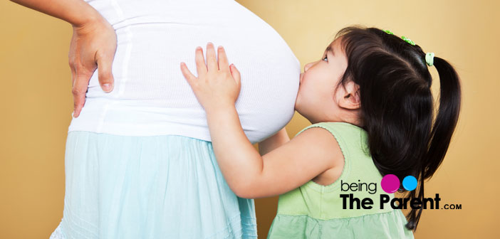 Pregnant woman with daughte