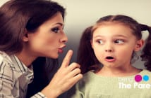 mother telling secret to daughter