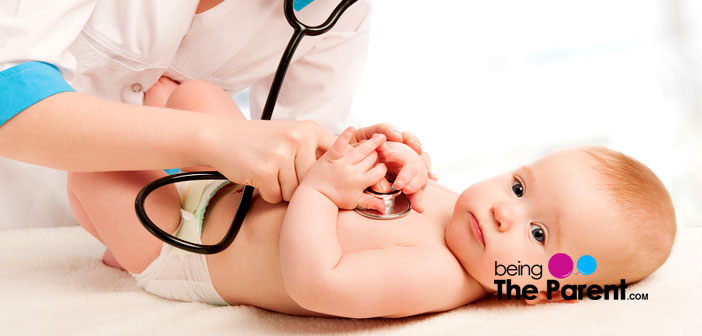 Pediatrician with a baby