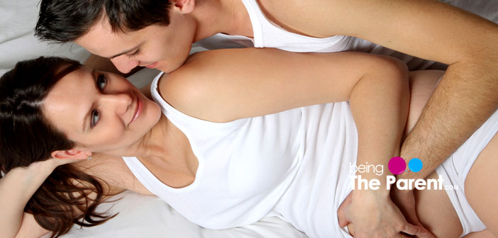 pregnant couple making love