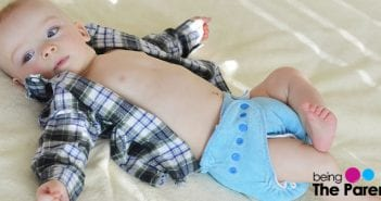baby wearing cloth diaper
