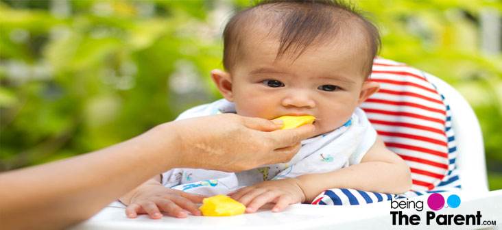baby eating mango