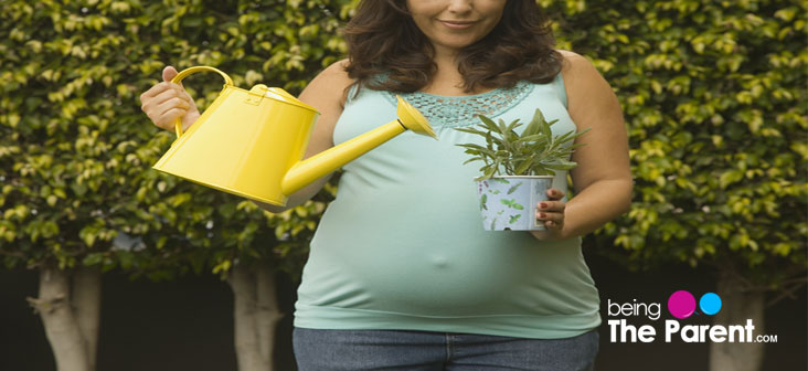 pregnant woman gardening