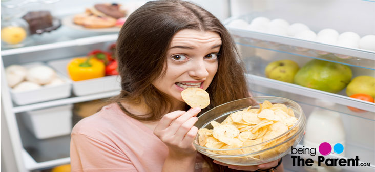 pregnant woman eating chips