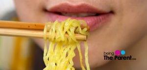pregnant woman eats noodles