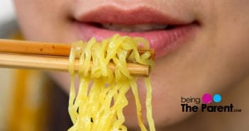 pregnant woman eats noodles