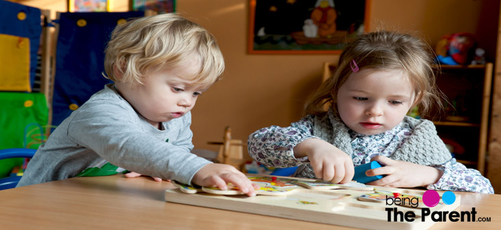 preschoolers playing puzzles