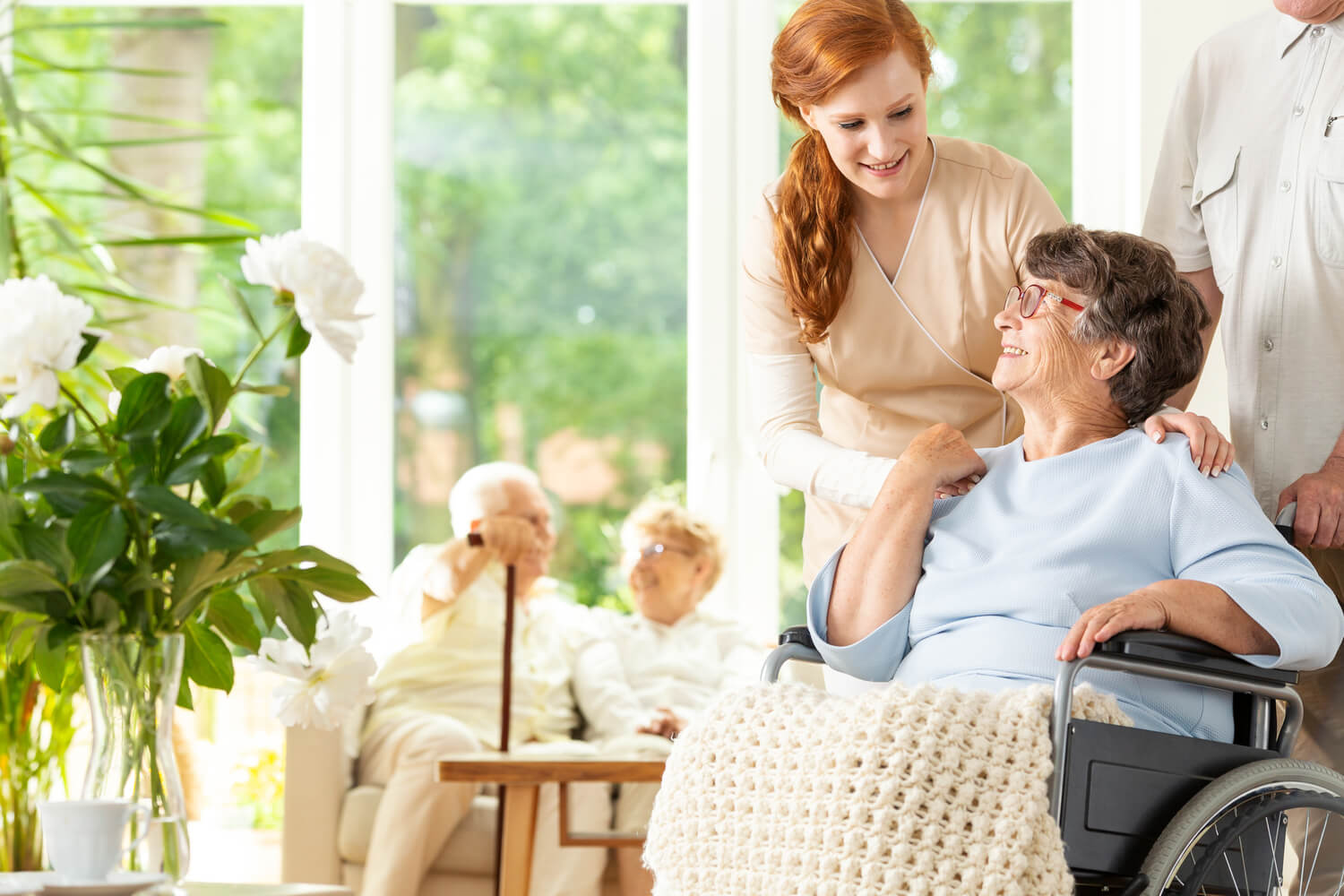 nurse taking care of old women in old age home