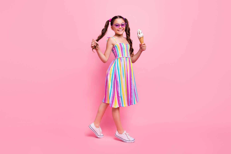 girl holding ice cream in hand