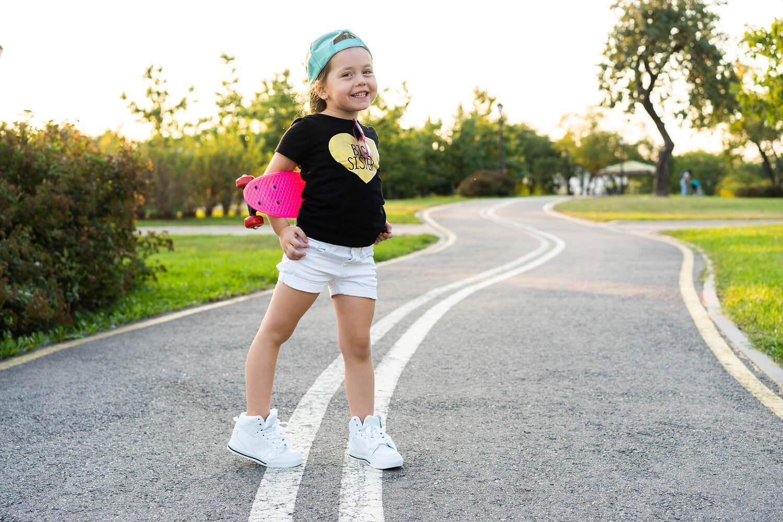 girl in shorts with skateboard